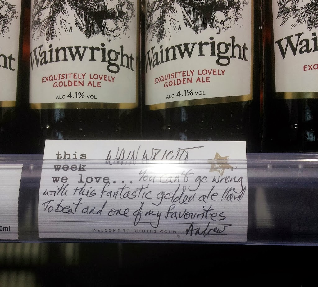 Wainwrights bottles with a recommendation card