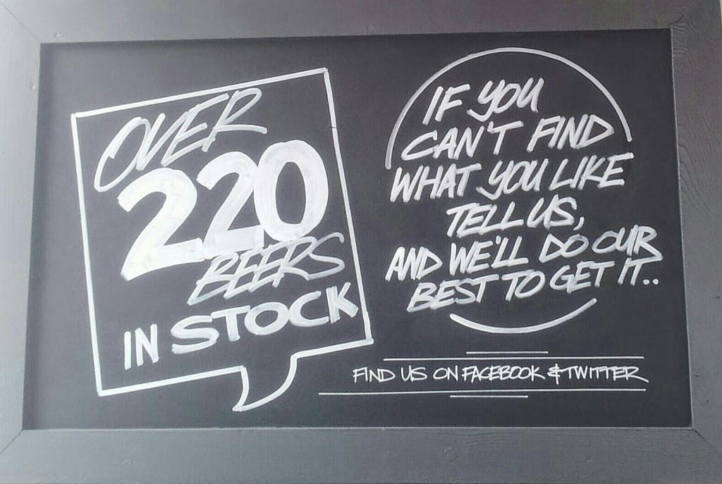 sign saying 'over 220 beers in stock, if you can't find what you like, tell us, and we'll do our best to get it... find us on facebook and twitter'