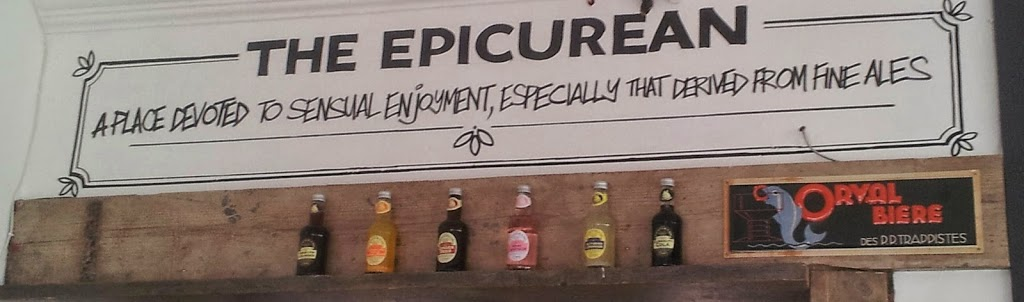 writing on the wall 'The Epicurean - a place devoted to sensual enjoyment, especially that derived from fine ales'