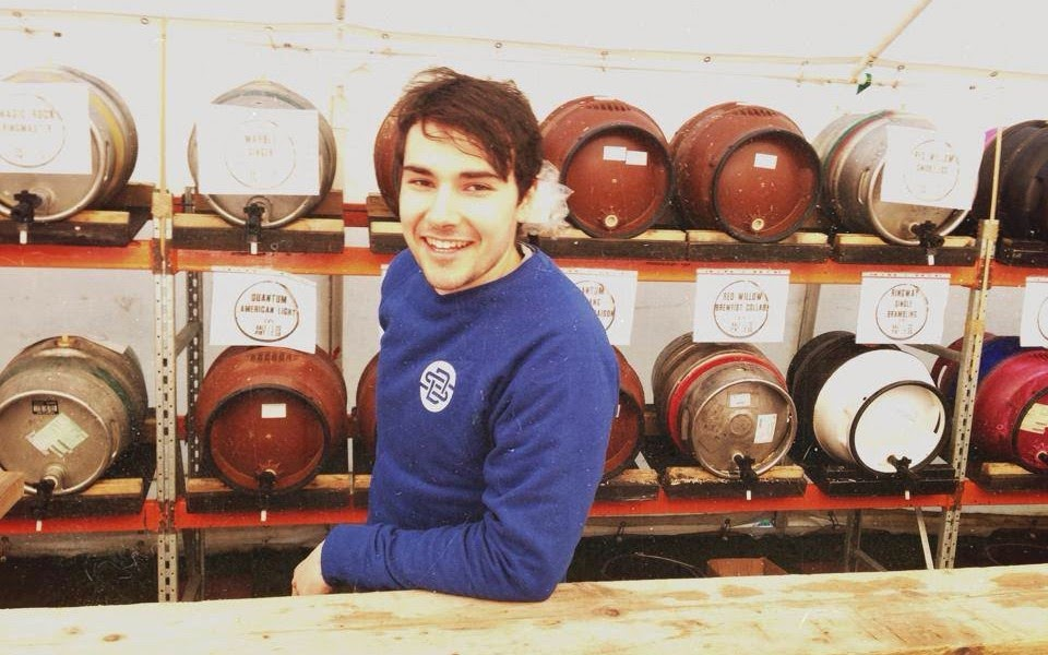 brewer at beer festival with casks