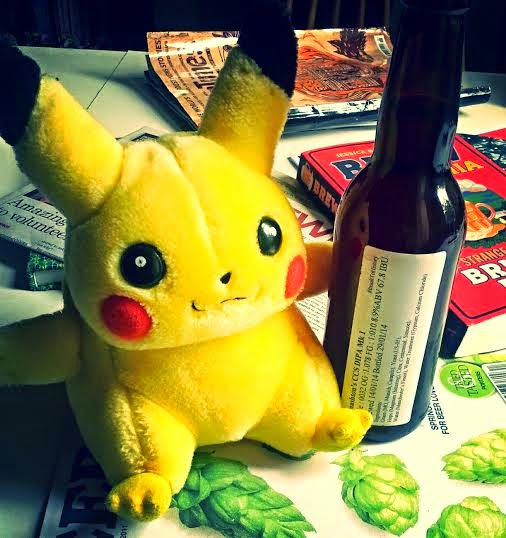 Pikachu cuddly toy next to a bottle of beer